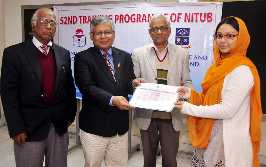 Dhaka University Pro-Vice Chancellor (Admin) Prof Dr Shahid Akhtar Hossain is seen distributing certificates among the participants of a week-long training program on
