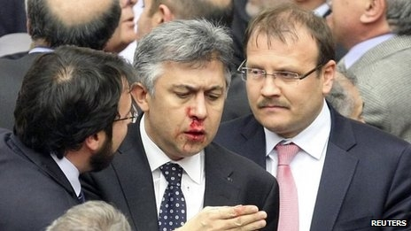 Turkish MPs pass judicial reforms amid brawl