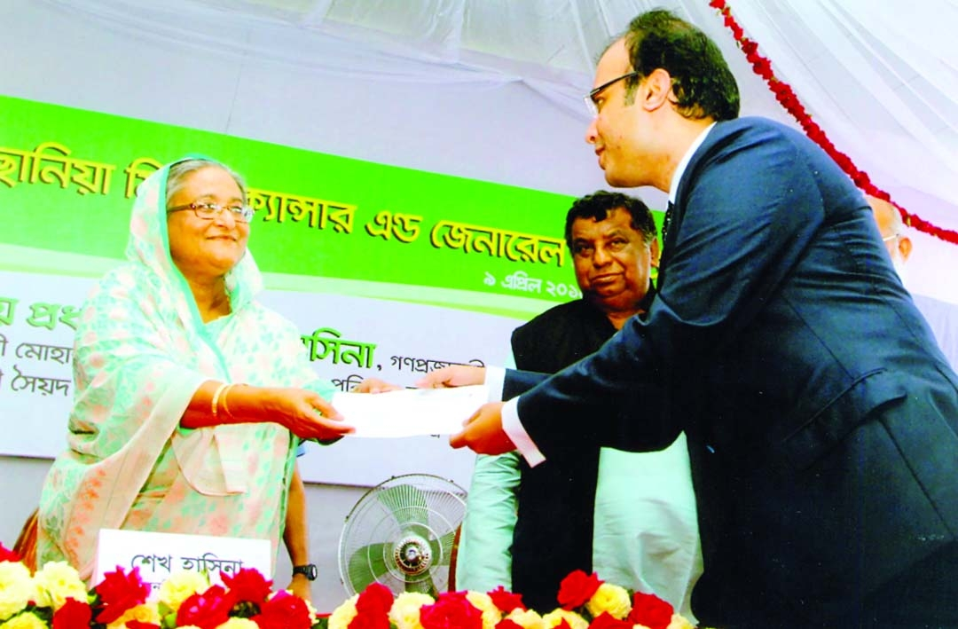 Prime Minister Sheikh Hasina receiving a cheque of Tk 15 crore from Dutch-Bangla Bank Chairman Sayem Ahmed  when she inaugurating Ahsania Mission Cancer and General Hospital Complex at Uttara on Wednesday.