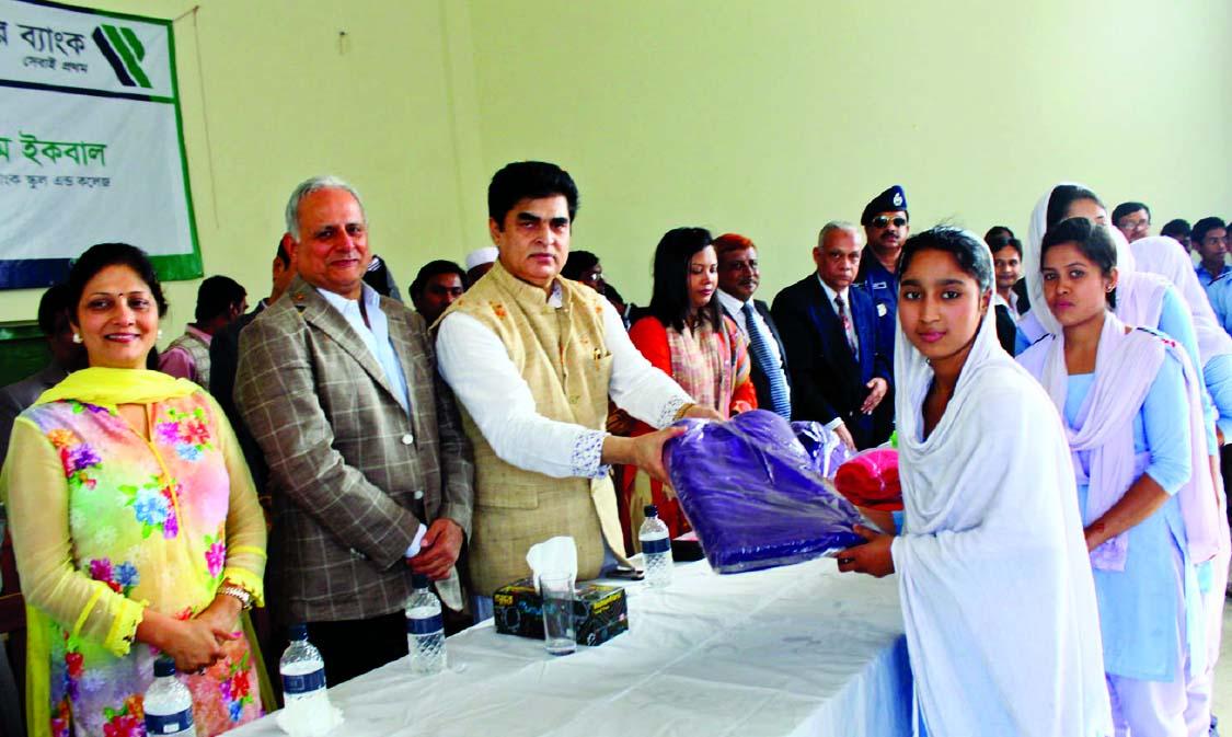 Dr HBM Iqbal, Chairman of Premier Bank Ltd, distributing blankets ...
