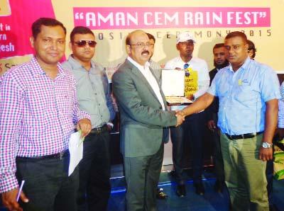 BOGRA: Hashem Ali, AGM, Aman Cement Mills Ltd handing over gold