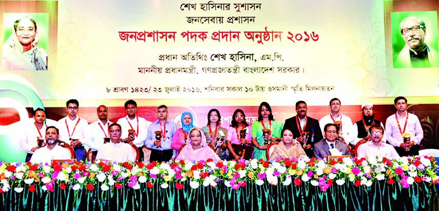 Prime Minister Sheikh Hasina poses for photograph with the recipients of Public Administration Medals at the medals distribution ceremony in Osmani Memorial Auditorium in the city on Saturday.