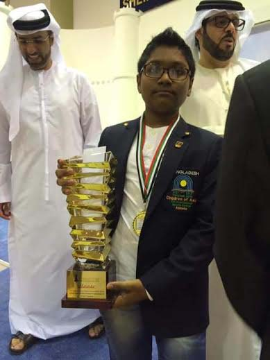 FM Mohammad Fahad Rahman of Sheikh Russel Memorial Chess Club poses with the 14th Dubai Juniors Chess Tournament title at Dubai in United Arab Emirates on Tuesday.