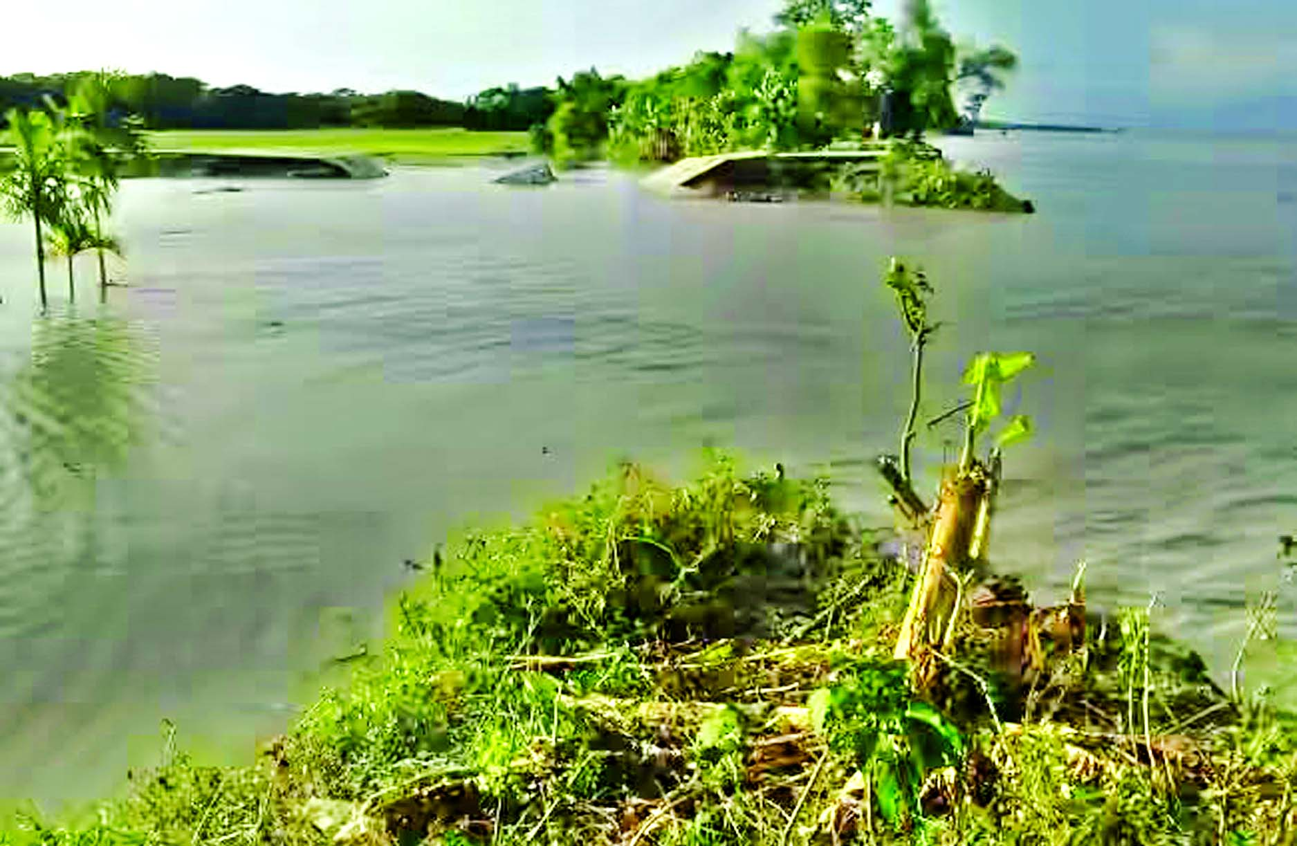 As the cross dam badly damaged by the cyclonic storm `Roanu` has not been repaired yet, many villages remained under water due to the influence of full and dark moon.  This photo was taken from Monpura in Bhola district on Monday.