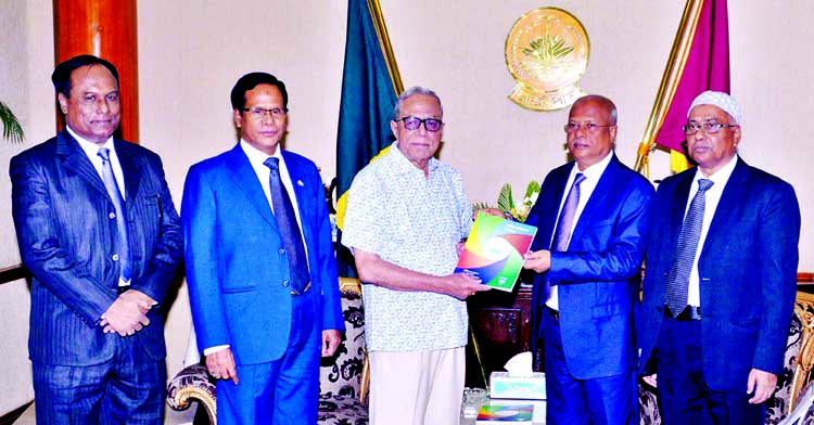 Anti-Corruption Commission Chairman Iqbal Mahmud handing over annual report-2015 of the commission to President Abdul Hamid at Bangabhaban on Monday.