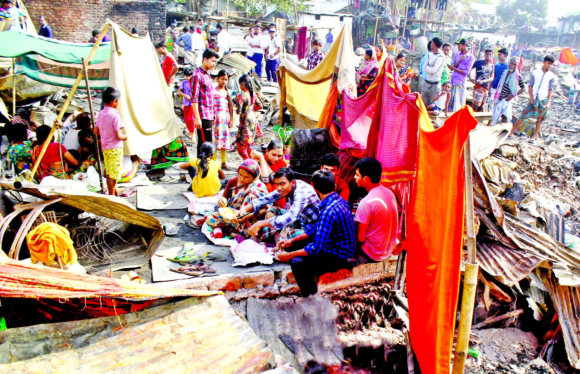 Hundreds of homeless slum dwellers living under the open sky after Korail shanties were gutted in fire on Sunday.