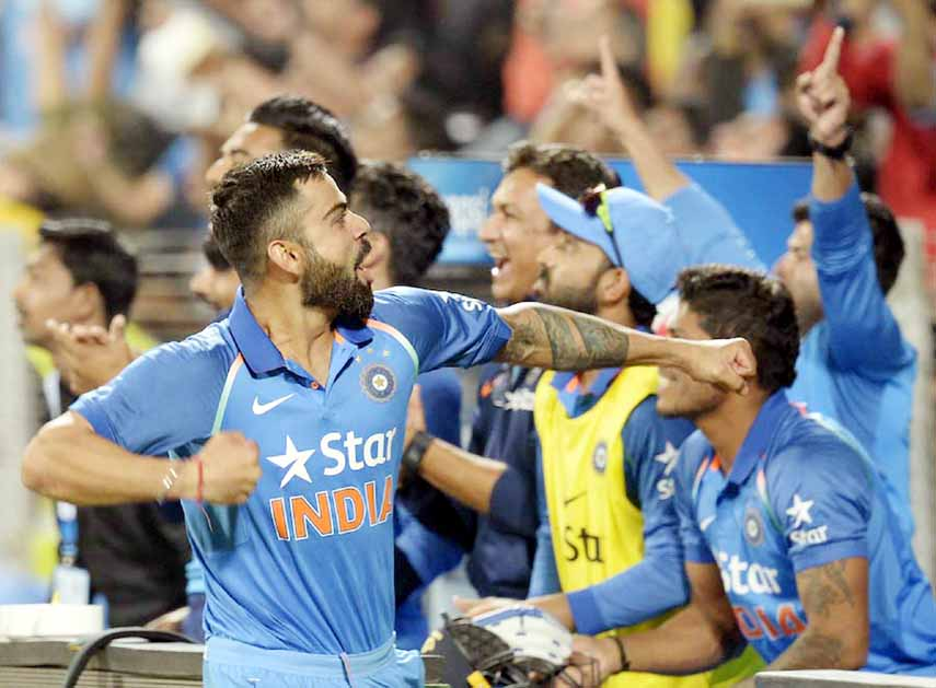 Kohli, Jadhav centuries help India beat England