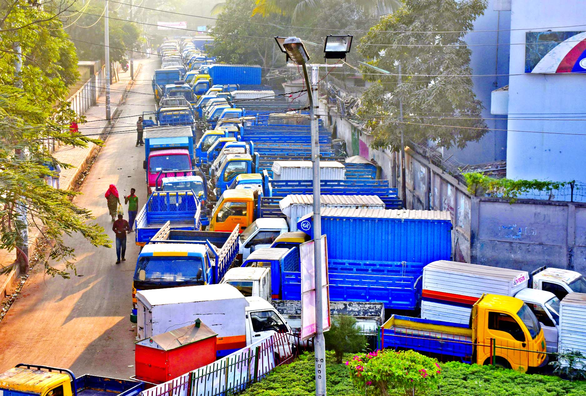 After eviction of illegal truck stand from Tejgaon area, was occupied by influentials keeping covered vans and trucks again. This photo was taken on Friday.