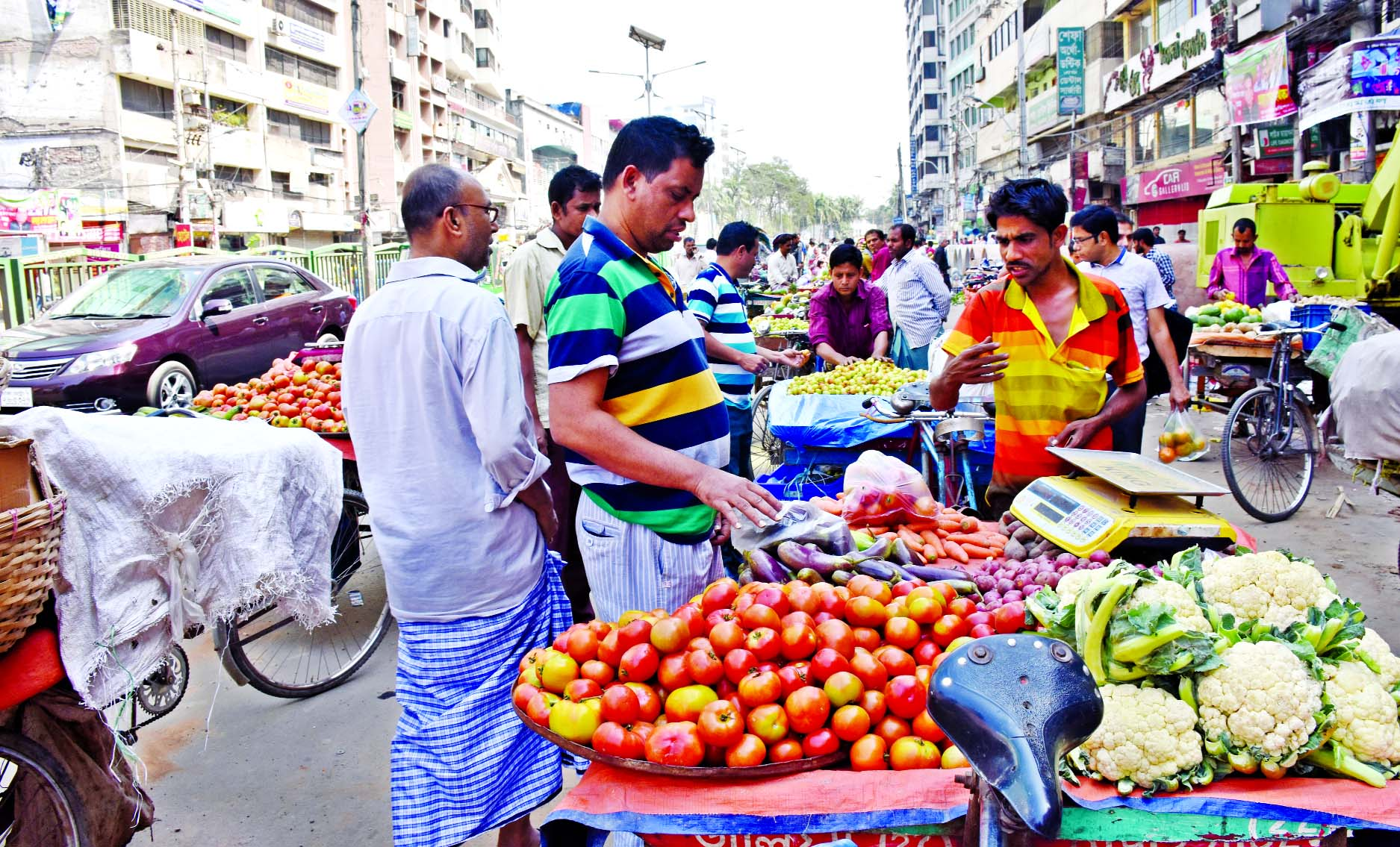Main thoroughfare in city is being occupied illegally by the vendors of vegetables and fruits in name of holiday market causing sufferings to commuters and pedestrians. This photo was taken from Naya Paltan area on Friday.