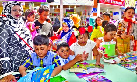 SHISHU PROHAR: Book-lover children are making their choice at a stall on Bangla Academy premises on the last Friday of Ekushey Book Fair.