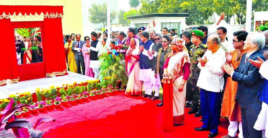 Prime Minister Sheikh Hasina inaugurating multistoried food warehouse having capacity of storing 25,000 tonnes of food grains at Santahar in Bogra on Sunday.