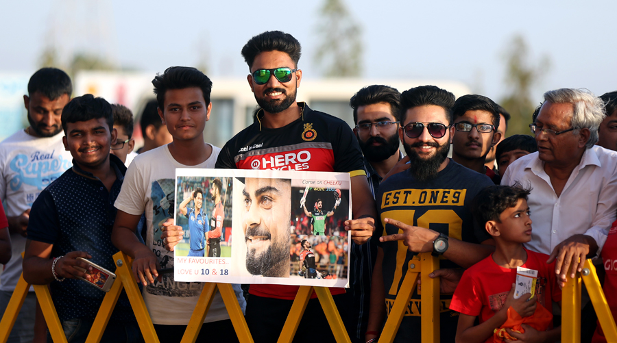 Fans queue up with posters of Virat Kohli ahead of the start of play between Royal Challengers Bangalore and  Gujarat Lions, Rajkot in  IPL 2017 at Bangalore on Tuesday.