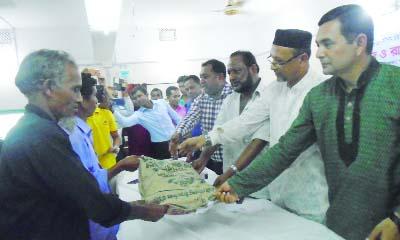 BETAGI(Barguna):  Sawkat Hasanur Rahman Rimon MP distributing seed and fertilizer among the farmers at Betagi Upazila  Parishad Auditorium as Chief Guest recently.  Alhaj A B M  Golum Kabir, Mayor, Betagi Pourashava was also present as special guest.