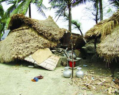 RANGABALI(Patuakhali):  Houses were damaged at Charmontaj Union by Nor'wester on Wednesday.
