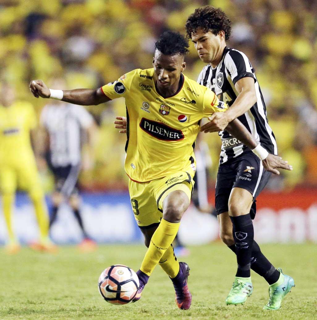 Dario Aimar of Ecuador's Barcelona (left) fights for the ball with Camilo of Brazil's Botafogo during a Copa Libertadores soccer match in Guayaquil, Ecuador on  Thursday.