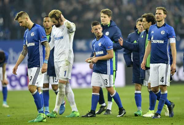 Schalke's team leaves the pitch disappointed after the Europa League quarterfinal second leg soccer match between FC Schalke 04 and Ajax Amsterdam in Gelsenkirchen, Germany. Schalke missed to reach the semifinal on Thursday.