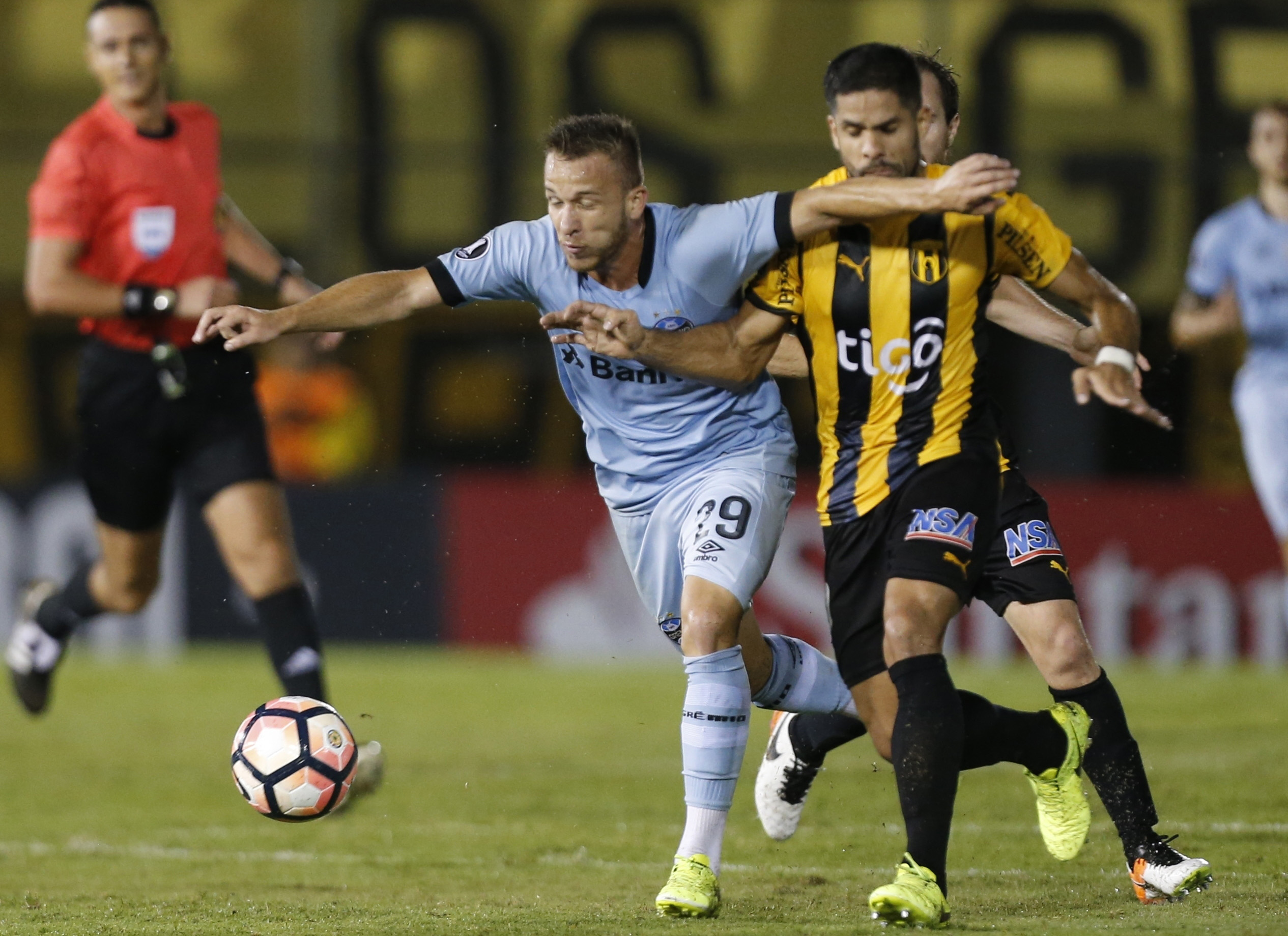 Beto da Silva (left) of Brazil's Gremio fights for the ball with Juan Aguilar of Paraguay's Guarani during a Copa Libertadores soccer game in Asuncion, Paraguay on Thursday.
