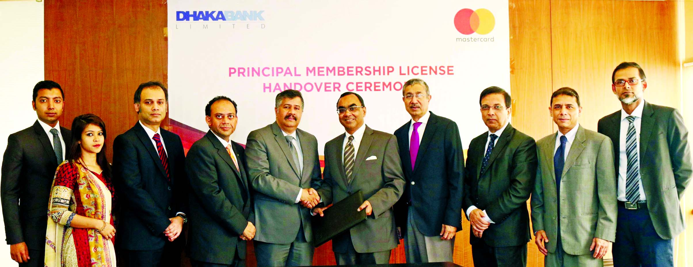 Syed Mahbubur Rahman, Managing Director of Dhaka Bank Limited and Syed Mohammad Kamal, Country Manager of Mastercard Bangladesh, exchanging documents after signed a deal at the bank head office in the city recently. Emranul Huq, AMD, Shafquat Hossain, Head of Retail Banking of the bank and Gitanka D Datta, Director of Mastercard Bangladesh and other high officials of both the organizations were present.