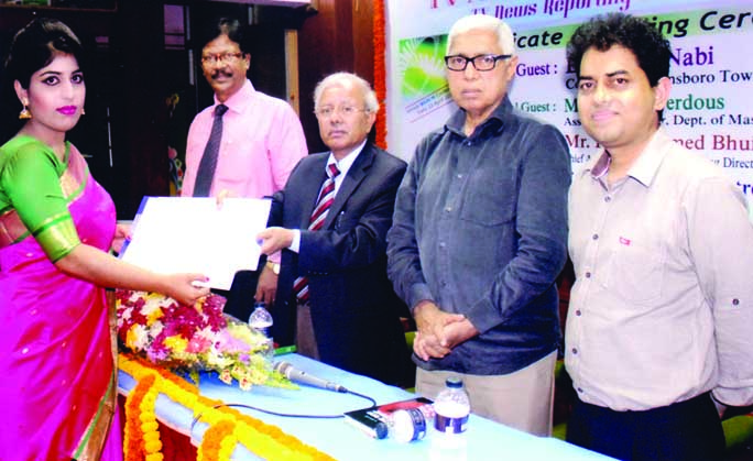 Dr. Nuran Nabi, Councilman, Plainsboro Township, New Jersey, USA, among others, at the certificate awarding ceremony of two training courses on 'TV News Presentation' and 'TV Journalism' organised by Bangladesh Institute of Journalism and Electronics Media at its seminar room in the city on Saturday.