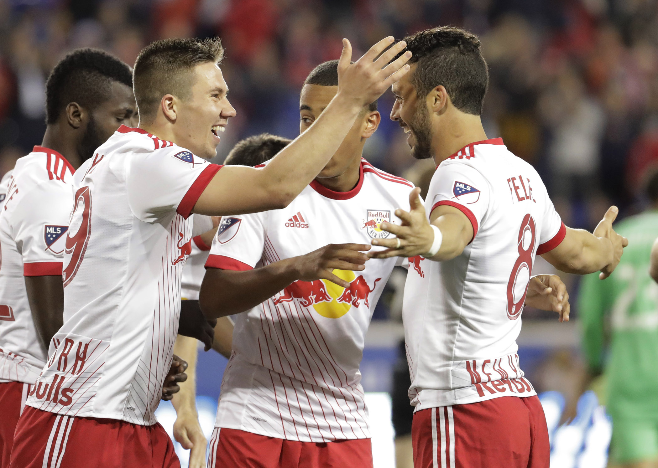 New York Red Bulls midfielder Alex Muyl (left) celebrates his goal with Felipe Martins, (right) and teammates during the first half of an MLS soccer match against Columbus Crew in Harrison, N.J on Saturday.