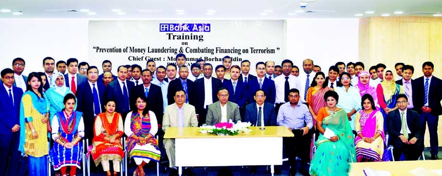 Mohammad Borhanuddin, DMD of Bank Asia Ltd, poses with the participants of a training program me on