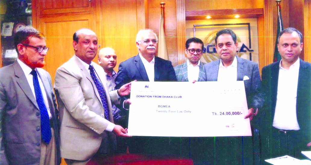 Member of the Executive Council of Dhaka Club Limited Abdus Selim handing over a cheque of Tk 24 lakh to BGMEA President Siddiqur Rahman for the assistance of Rana Plaza victims at a ceremony held in the city on Sunday.