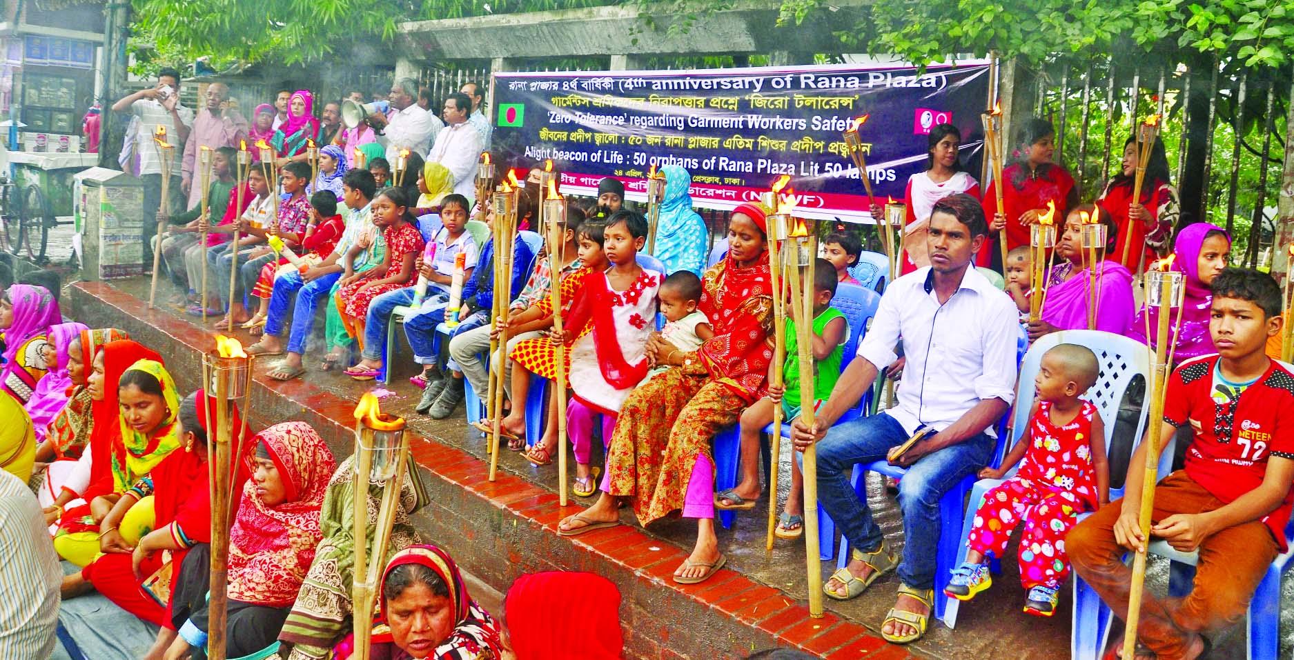50 orphans lit lamps at a rally organised by Jatiya Garments Sramik Federation  in front of the Jatiya Press Club on Monday marking Rana Plaza Tragedy Day.