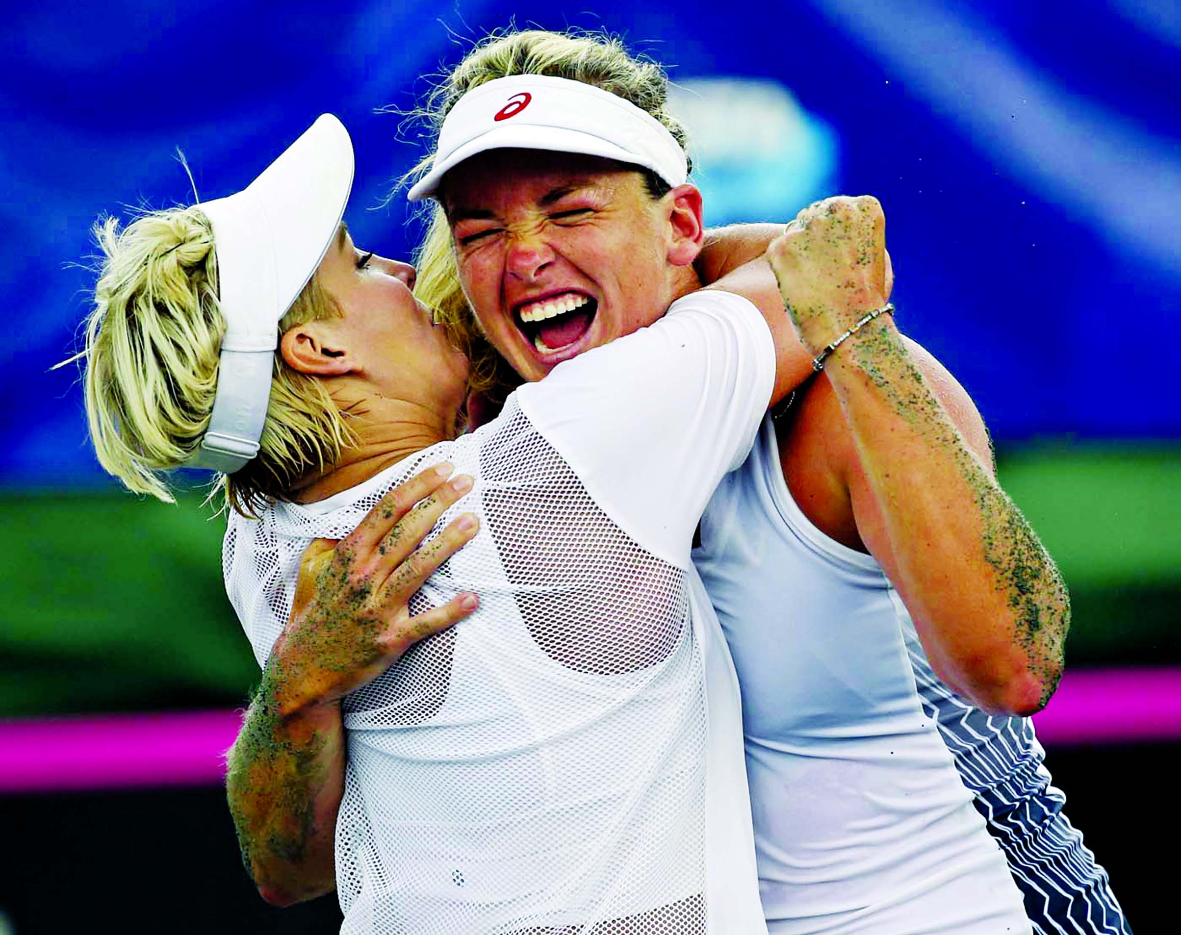 United States team players Bethanie Mattek-Sands (left) and CoCo Vandeweghe celebrate after defeating Czech Republic players Kristyna Pliskova and Katerina Siniakova during a Fed Cup semifinal doubles tennis match in Wesley Chapel, Fla on Sunday.