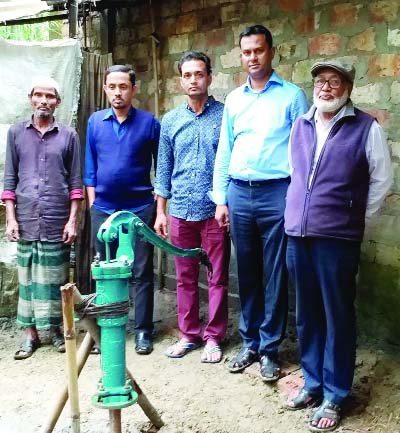 SYLHET:  Musaddek Hussain Sajul, Secretary, Bishawanath Press Club distributing tube- well at Chotrish Village recently.