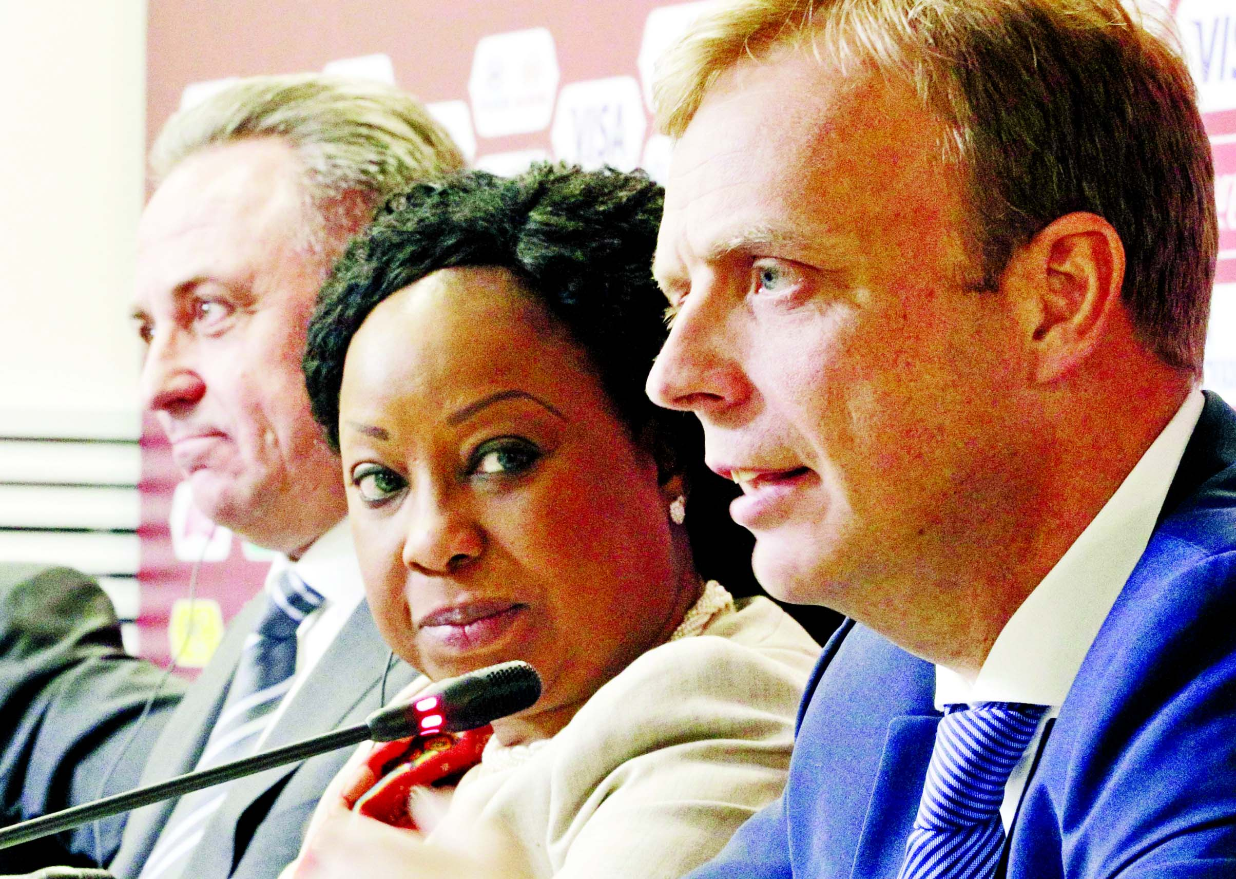 Colin Smith, FIFA`s Competitions Director (right) FIFA Secretary General Fatma Samoura (centre) and Vitaly Mutko, Russia's deputy prime minister in charge of sport, tourism and youth policies, attend a news conference after the Russia 2018 LOC Board meeting with FIFA participation in St.Petersburg, Russia on Tuesday.