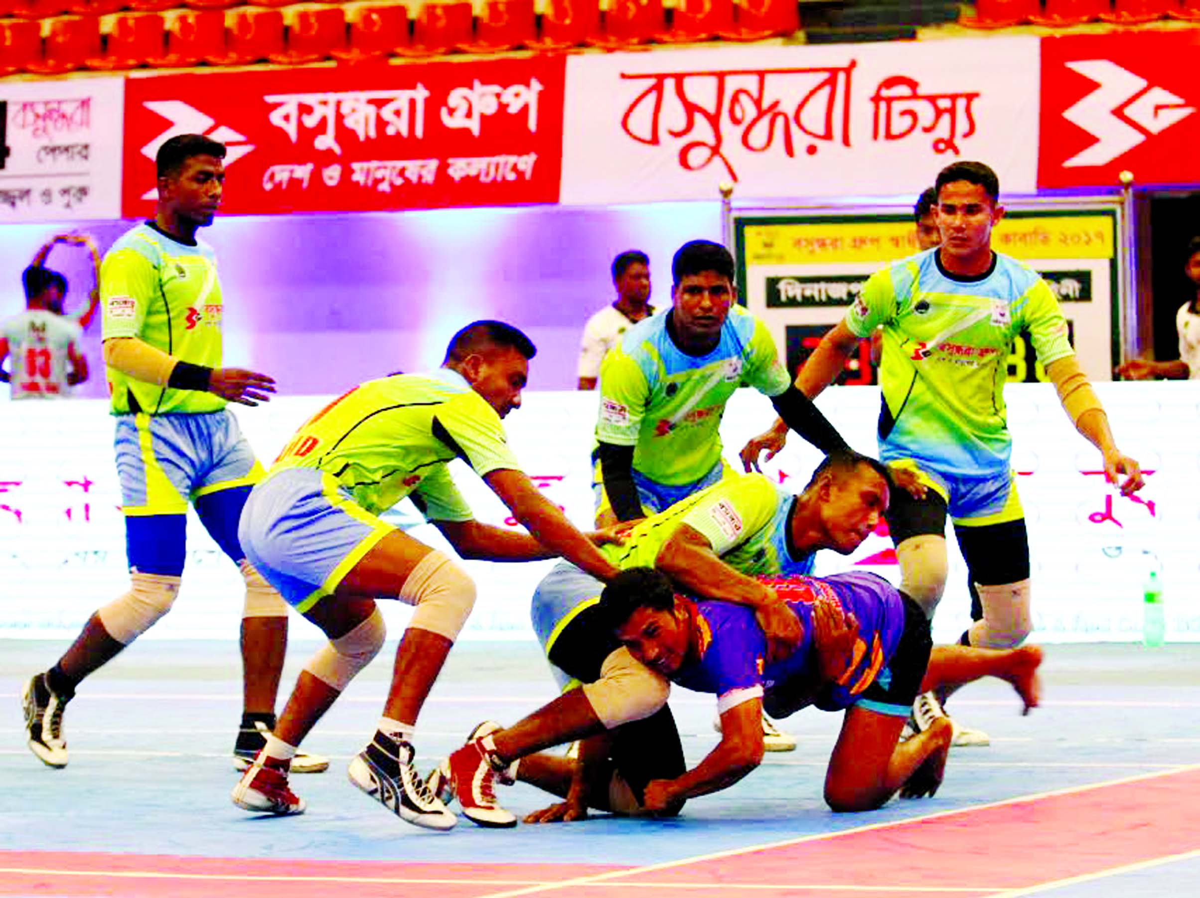 A moment of the match of the Bashundhara Presents Independence Cup Kabaddi Tournament between Bangladesh Army and Dinajpur District team at the Shaheed Suhrawardy Indoor Stadium in Mirpur on Tuesday.