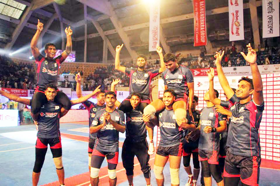 Players of Bangladesh Navy celebrating after defeating Bangladesh Army by 36-26 points in the first semi-final of the Bashundhara Presents Independence Cup Kabaddi Tournament at the Shaheed Suhrawardy Indoor Stadium in Mirpur on Wednesday.