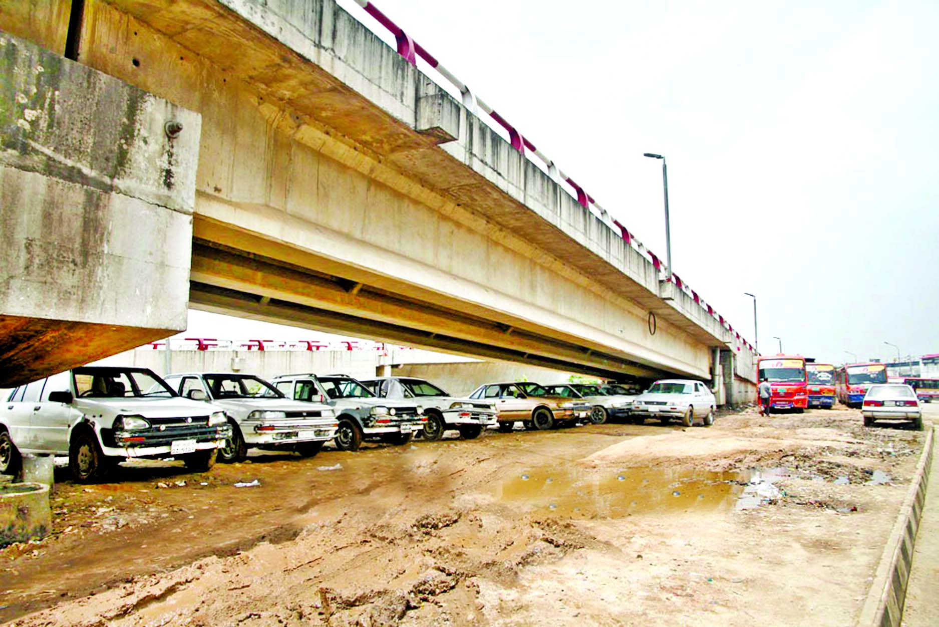 Cars being parked illegally under the Kuril Flyover. This photo was taken on Wednesday.