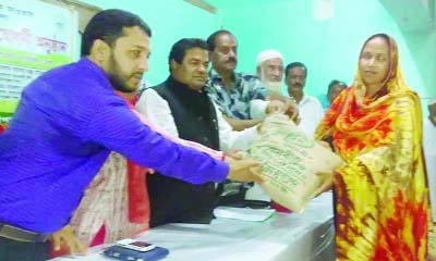 BANARIPARA( Barisal) : Adv. Talukder Md. Younus  MP distributing seed and fertilizer free of cost among the marginal farmers yesterday.