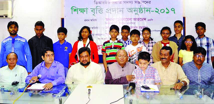 Commerce Minister Tofail Ahmed along with others at the stipend giving ceremony organised for the wards of late members of Dhaka Reporters Unity at its auditorium on Friday.