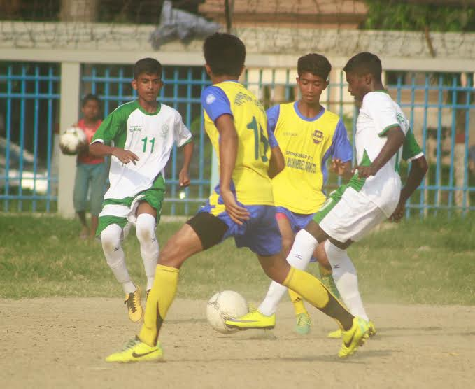 A scene from the match of the Dhaka North City Corporation and Dhaka South City Corporation Pioneer Football League between Wazed Miah Krira Chakra and Alhaj Nur Islam Football Academy at the Paltan Maidan on Friday. Wazed Miah Krira Chakra won the match 3-0.