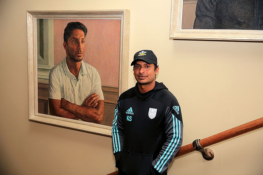 Kumar Sangakkara poses in front of his newly unveiled portrait in the Lord`s Pavilion on Thursday.