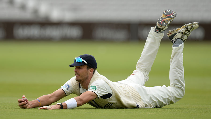 Steven Finn made good ground for a catch during the Specsavers County Championship, Division One match between Middlesex and Surrey at Lord's on Saturday.
