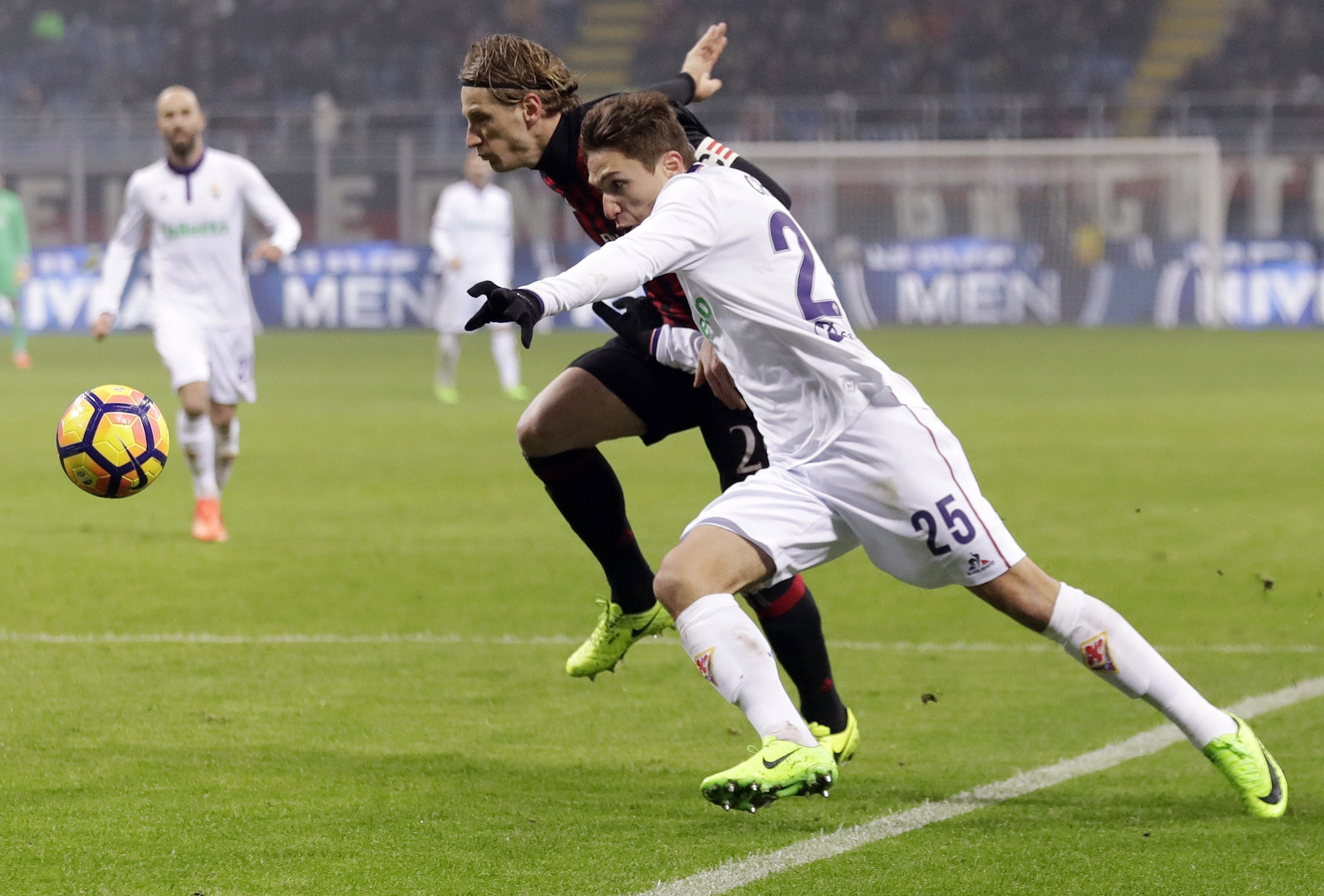 In this Feb. 19, 2017 file photo, Fiorentina's Federico Chiesa (right) and AC Milan's Ignazio Abate go for the ball during a Serie A soccer match at the San Siro stadium in Milan, Italy. Italy's hopes may rest on the shoulders of Federico Chiesa of Fiorentina who has already established himself in Italy's top tier, Serie A.