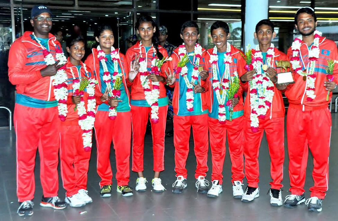 Members of Bangladesh Under-12 Tennis team pose for a photo session at the Hazrat Shahjalal International Airport on Saturday. Bangladesh Boys' Under-12 Tennis team emerged as the champions of the ITF Asian Under-12 team event tennis competition held at Kathmandu in Nepal on Friday.
