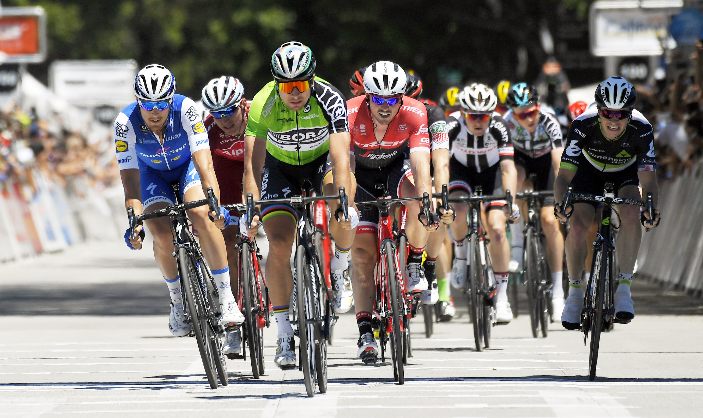 Peter Sagan (third from left) of Slovakia crosses the finish line as he wins the sprint portion of the Amgen Tour of California cycling race, on Saturday in Pasadena, Calif.