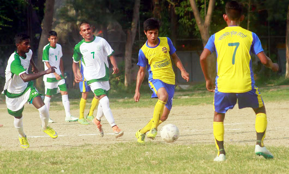 A scene from the match of the Dhaka North City Corporation and Dhaka South City Corporation Pioneer Football League between Chandpur Football Academy and Jhilmil Football Academy at the Paltan Maidan on Sunday. Chandpur Football Academy won the match 4-0.