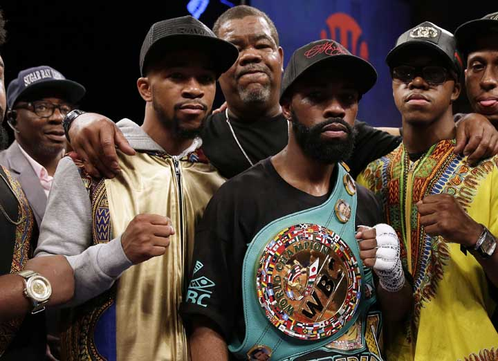 Gary Russell Jr. (center) celebrates with his team after winning the WBC featherweight title fight against Oscar Escandon in Oxon Hill, Md on Saturday.