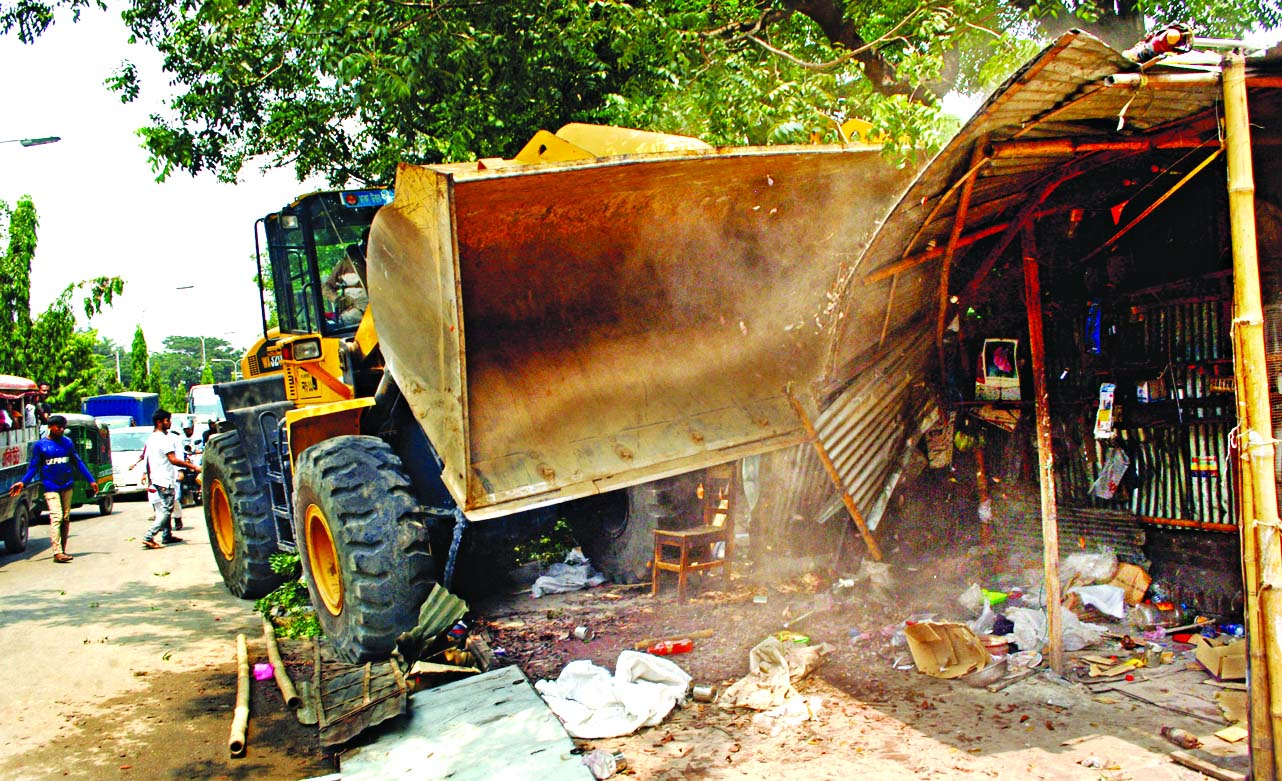 Illegal structures on both sides of the road at Sher-e-Bangla Nagar was bulldozed as part of the regular eviction drive by the Dhaka North City Corporation on Monday.