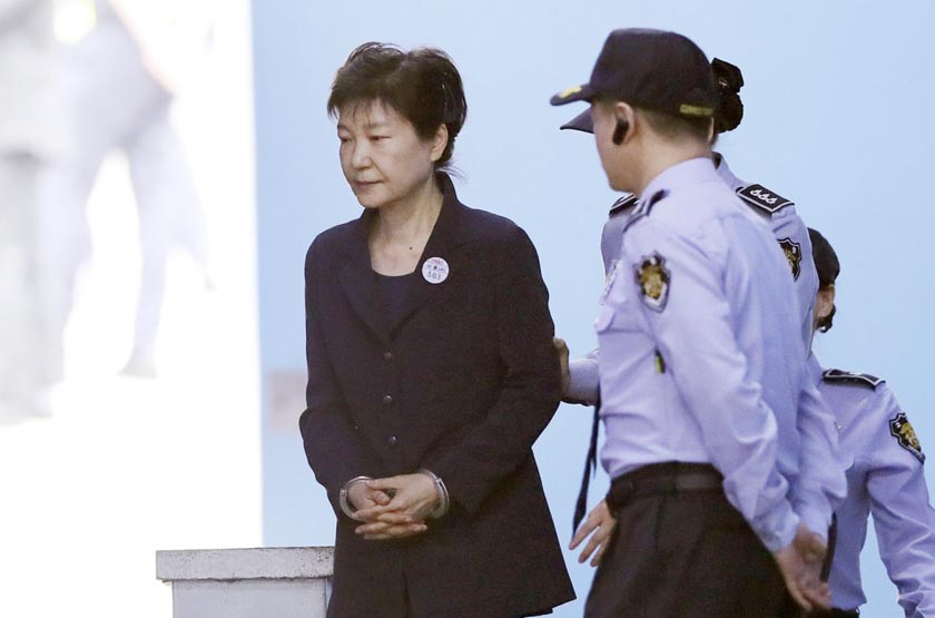 South Korea's ex- president Park denies charges as corruption trial begins