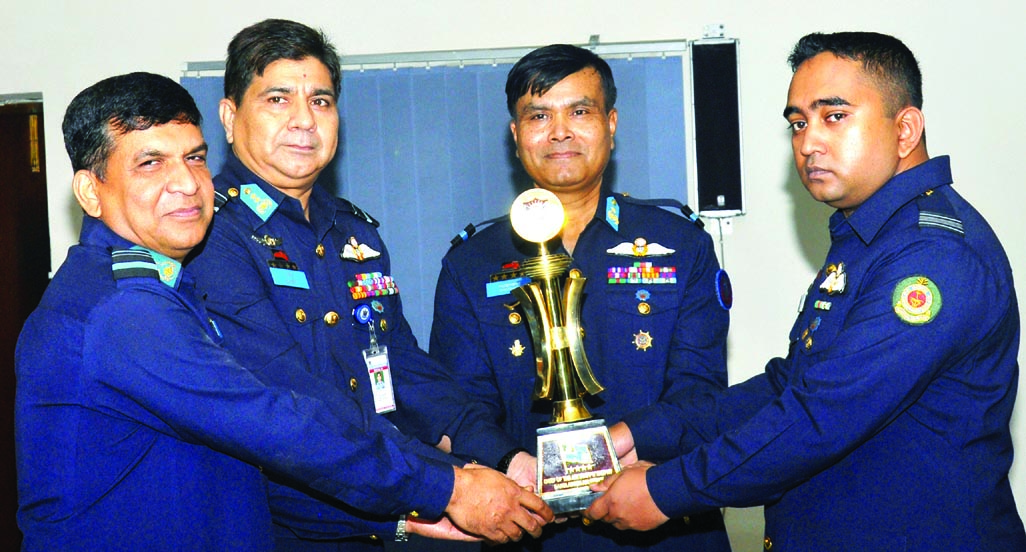 Assistant Chief of Air Staff (Operations and Training) Air Vice Marshal  M Naim  Hassan giving away the 'Chief of Air Staff's Trophy' to Squadron Leader  SM Shakhawat Anwar of BAF for his best performance in '104 Junior Command and Staff Course' at CSTI, BAF Base Bashar, Dhaka Cantonment  on Tuesday.