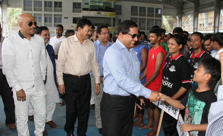 State Minister for Textile and Jute Mirza Azam being introduced with the participants of the Sheikh Russel 12th National Wushu Championship as the chief guest at the Sheikh Russel Roller Skating Complex on Tuesday.