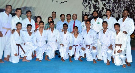 The participants of the day-long karate training workshop with the chief guest Senior Secretary of the Ministry of Public Administration and President of Bangladesh Karate Federation (BKF) Dr Md Mozammel Haque Khan and the other officials of BKF pose for a photo session at the gymnasium of National Sports Council on Thursday.
