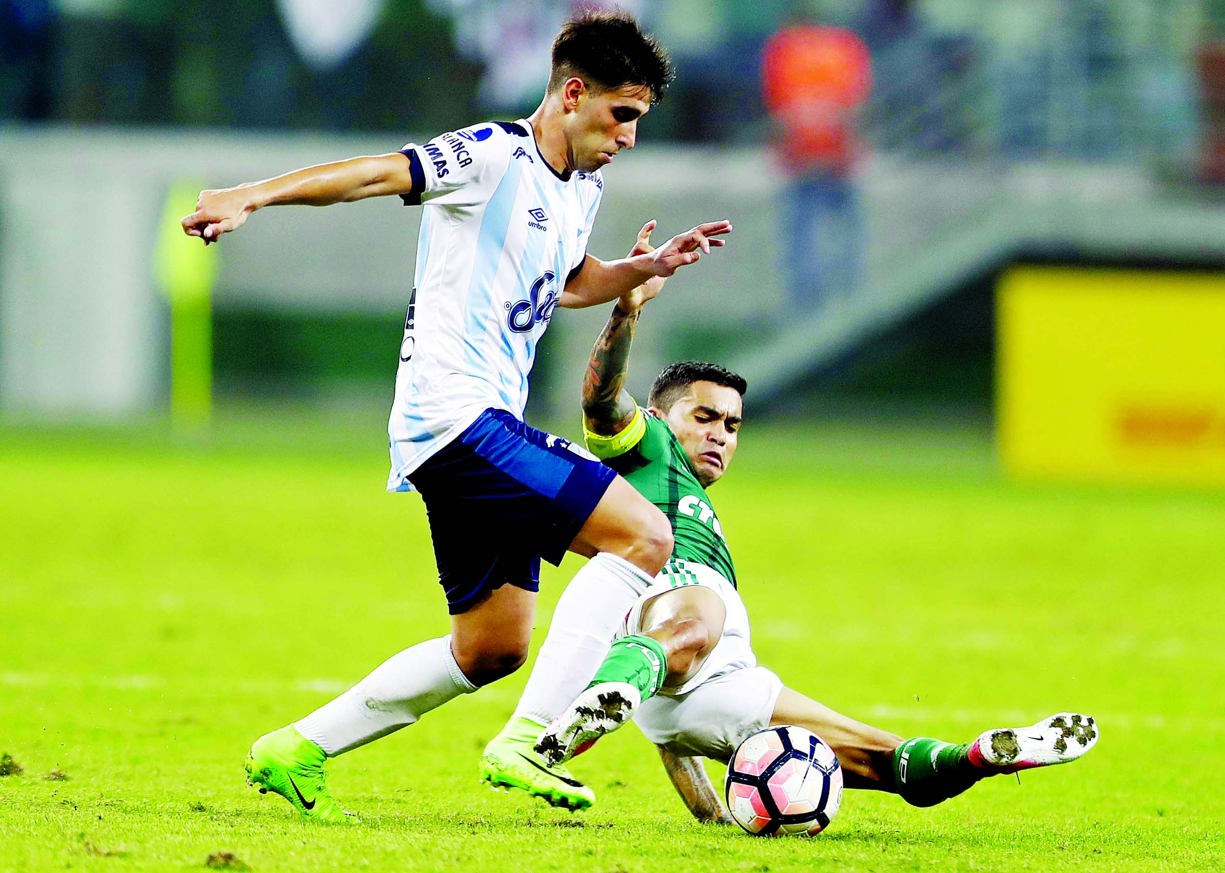 Dudu of Brazil`s Palmeiras (right) fights for the ball with Leonel Di Placido of Argentina`s Atletico Tucuman, during a Copa Libertadores soccer match in Sao Paulo, Brazil on Wednesday.