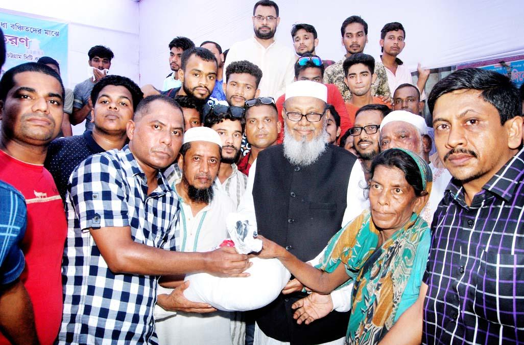 Former CCC Mayor and Chittagong City Awami League President Alhaj ABM Mohiuddin Chowdhury distributing iftar items on behalf of Chaktai Moholla and Samaj Kalyan Sangstha yesterday.